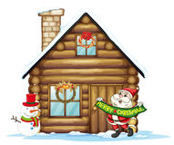 House and santa claus Stock Images