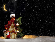 House of Santa Claus. Christmas still life with falling snow Stock Images