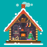 House of Santa Claus. Interior of the house with a fireplace, Christmas tree, gifts, decorations. Vector flat illustration Stock Photos