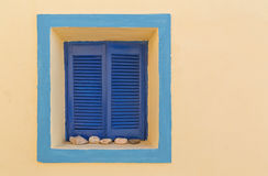 House on Santorini with window with closed shutters Royalty Free Stock Photography