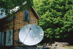House with satellite dish Royalty Free Stock Photography