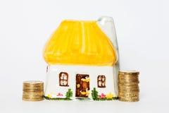 House saving. Saving pound coins for buying a house. Money box Royalty Free Stock Photos
