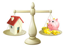 House or savings scale concept. House money cales concept. Piggy bank on one side of a scale and a house on the other. Can have several meanings relating to real Royalty Free Stock Photos