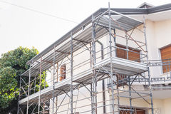 House and scaffold. House for renovation with the scaffolding for bricklayers Royalty Free Stock Photos