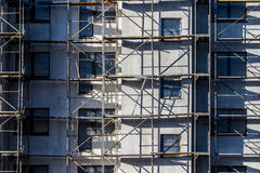 The house and scaffolding. The unfinished build house and scaffolding Stock Images
