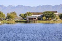 House on scenic lake Stock Image