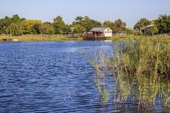 House on scenic lake Royalty Free Stock Photos