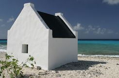 House by the sea. Slave huts sheltered those who worked in the salt pans on Bonaire, Dutch caribbean island.West Indies Stock Images