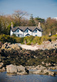 House by the sea. White house by the sea Royalty Free Stock Photography