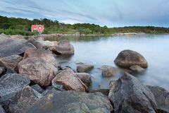 House by the sea. Red house by the coast of Karlshamn, Blekinge, Sweden Royalty Free Stock Photography