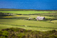 House by the sea. An isolated farmhouse next to the Atlantic Ocean in Cornwall. Selective focus on house Stock Photos