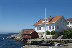 House by the sea. House and boathouse by the sea in Loshavn near Farsund in Vest-Agder on the south coast of Norway Royalty Free Stock Images