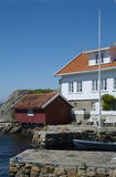 House by the sea. House and boathouse by the sea in Loshavn near Farsund in Vest-Agder on the south coast of Norway Stock Photo