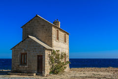 House by the sea Royalty Free Stock Image