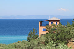 House by the sea , in olive groove Royalty Free Stock Photography