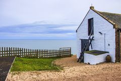 House by the sea. St Cyrus, Aberdeenshire, Scotland stock photography