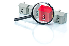 House search concept, house model with magnifying Stock Photography
