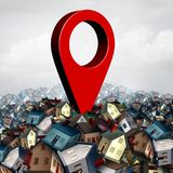 House Search Location. House search finding a home and find property concept as a pin on a group of family houses as a real estate buying or locating a residence Royalty Free Stock Image