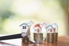 House searching concept with a magnifying glass, house and money. magnifying glass and coins. concept of mortgage, construction,. Rental housing stock photo