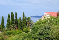 House on seaside. House with red tiled roof in montenegro Royalty Free Stock Photos