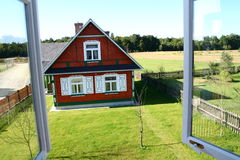 House seen from the window. Traditional style village house in Poland royalty free stock photography