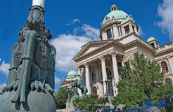 House of Serbian National Assembly with national symbols. Belgrade, Serbia - September 24, 2014: National symbols and monumental and dynamic man and horse royalty free stock photo