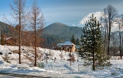 The house is set against the beautiful mountains on a Sunny winter morning Royalty Free Stock Photo