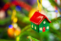 House shape bauble on christmas tree Royalty Free Stock Photography