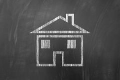 House shape on blackboard Royalty Free Stock Images