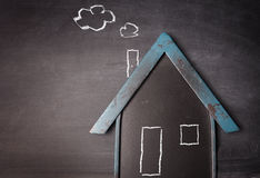House shape on a blackboard Royalty Free Stock Images