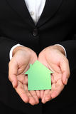 House shape in business woman's hands stock photo