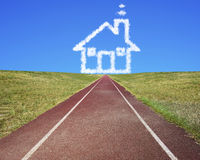 House shape clouds in blue sky with running track Royalty Free Stock Images