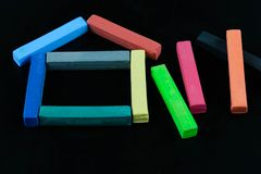 House shape of Colourful chalk pastel on black background. Concept for education royalty free stock photos