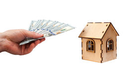 House shape made of wooden blocks and currencies dollar with man hand Royalty Free Stock Photo