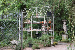 House shape metal truss structure in the English garden Royalty Free Stock Image