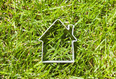 House shape over green grass Royalty Free Stock Images