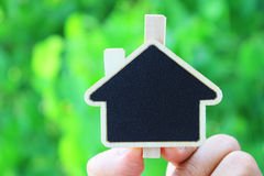 House shape sign on green Stock Photo