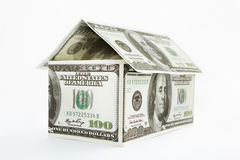 House shaped dollars. House shape made from 100 dollar bills over white background Royalty Free Stock Photography