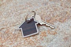 House shaped keychain and key Royalty Free Stock Photo