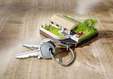 House shaped keychain with keys on wooden surface. 3d rendering Royalty Free Stock Photos