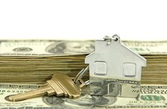 House shaped keychain with money Stock Image