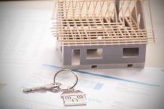 House shaped keyring. On document Stock Photo