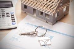 House shaped keyring. On document Royalty Free Stock Photography