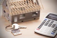 House shaped keyring. On document Stock Photography