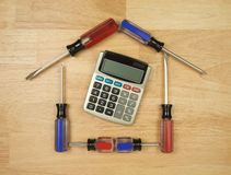 House Shaped by Screwdrivers and Calculator Royalty Free Stock Photo