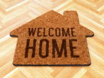 House shaped Welcome mat on wooden floor. Brown house icon shape coir doormat with text print Welcome Home on wooden floor. 3D illustration vector illustration