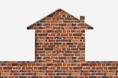 House shaped white wall with bricks behind Royalty Free Stock Photography