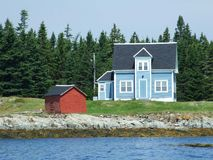 House and shed. Blue house with white trim and a red shed on Outer Hirtle Island Lahave Lunenburg County Nova Scotia Canada royalty free stock photography