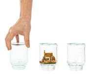 House and shell game with glass jars Stock Images
