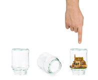House and shell game with glass jars Royalty Free Stock Image